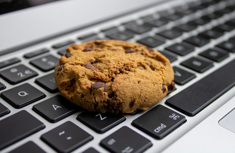 Chocolate Chip cookie on laptop keyboard